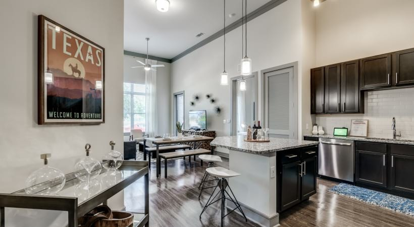 Kitchen island with wine rack and modern lighting at our spacious apartments in Frisco, TX