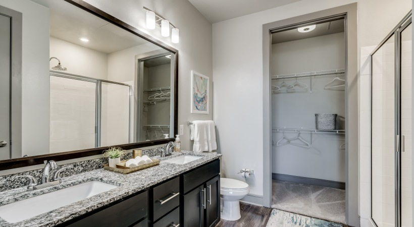Spacious bathroom with double sink vanities and walk-in showers at our luxury apartments at Circa Verus Frisco