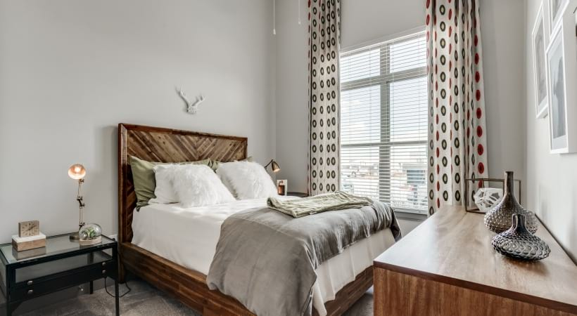 Bedroom with natural lighting at our spacious apartments in Frisco, TX