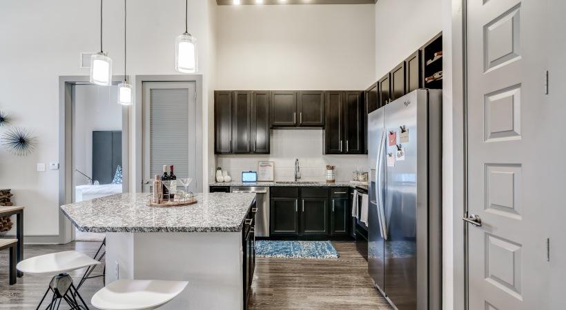 Verus style luxury apartment with granite kitchen countertops at in Circa Verus Frisco