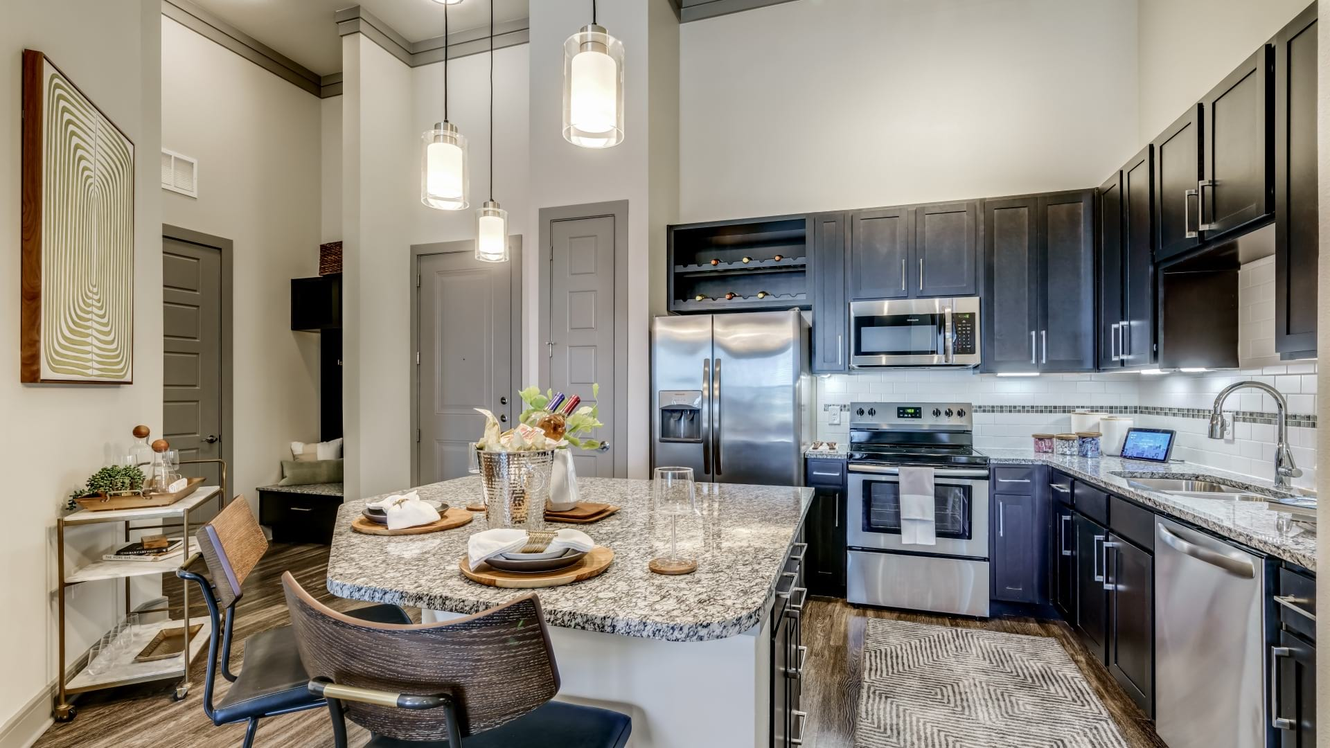 Cortland apartments in Frisco, TX with open concept kitchen including expansive kitchen island and modern cabinetry