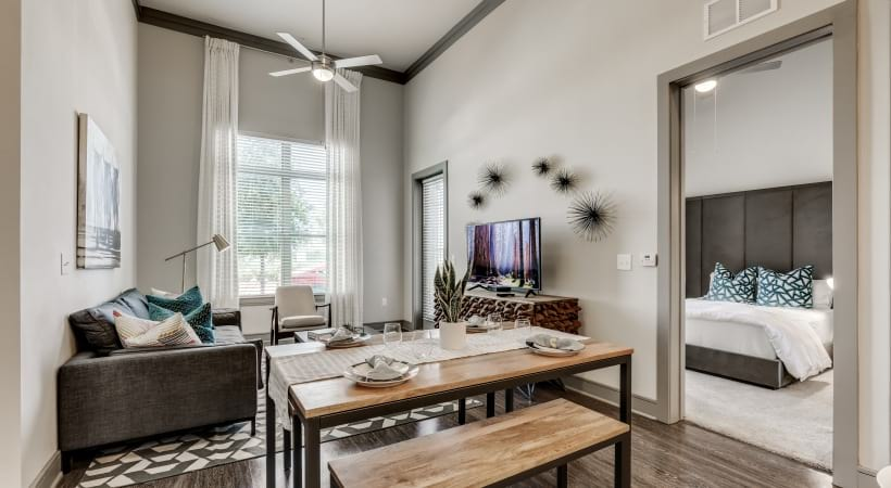 Our modern apartments in West Plano, TX with tall ceilings and open-concept living and dining room