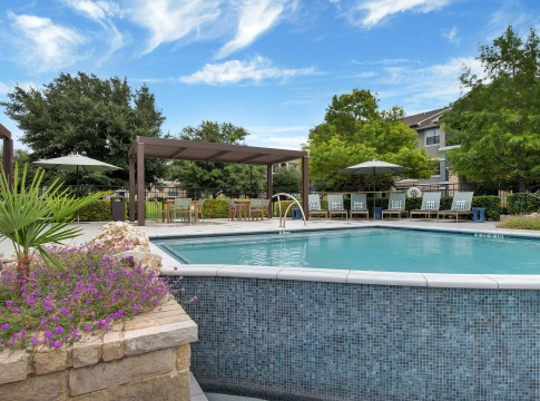 Resort-style pools and sun deck at Cortland Southpark Estates