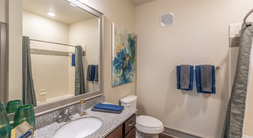 Apartment bathroom with granite countertops
