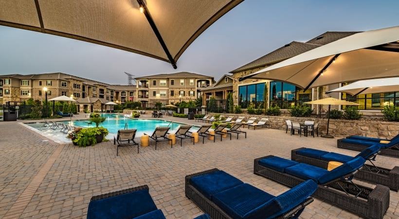 Lounge chairs by resort style pool at Cortland Preston North