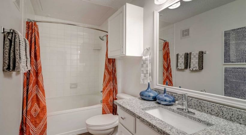 Luxury bathroom with garden-tub and granite countertops at our Irving apartments for rent