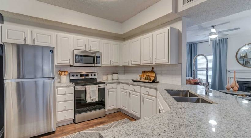 Luxury apartments in Irving with spacious updated kitchen and sleek granite countertops