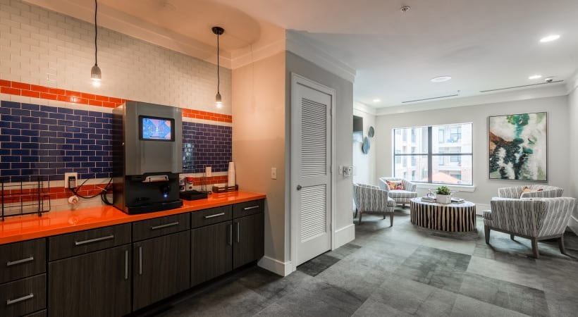 Resident clubhouse with coffee bar at apartments in Katy, TX