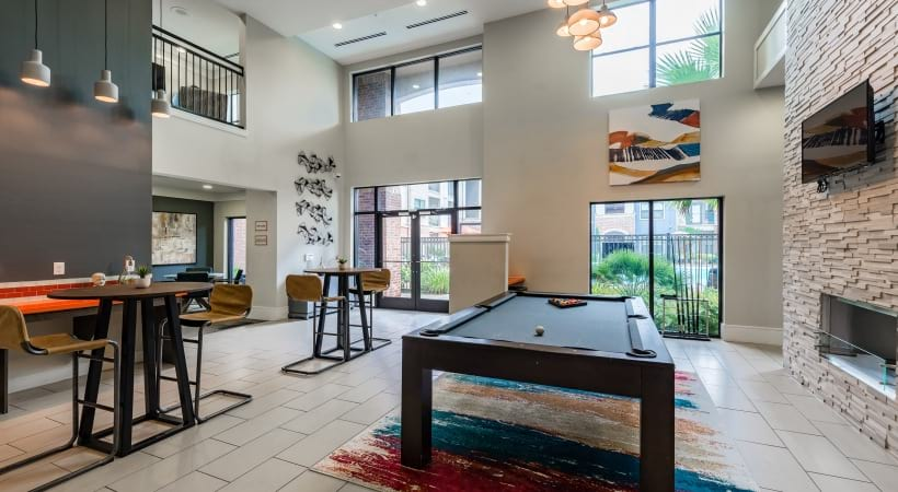 Resident clubhouse with pool table at apartments in Katy, TX