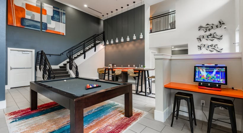 Resident clubhouse with pool table at apartments near Katy, TX