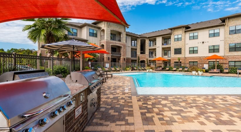 BBQ Grills by the resort style pool at Cortland Cinco Ranch