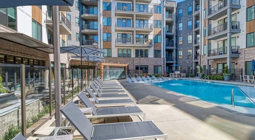 Resort-Style Swimming Pool With Lounging Chairs At Our Apartments In North Druid Hills, Atlanta, GA