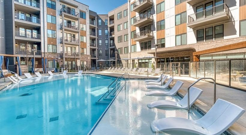 Resort-Style Swimming Pool With Lounging Chairs At Our Apartments Near Briarcliff Road