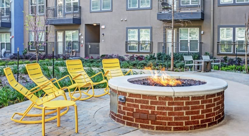 Outdoor fire pit at Cortland Oak Lawn apartments