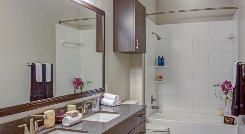 Sleek Granite Countertops with Double Sink Vanities