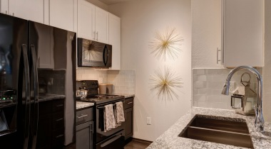 Energy-efficient, black kitchen appliances at our Far West Side San Antonio apartments