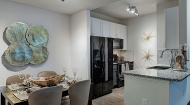 Kitchen with Modern Lighting at Our Upscale Apartments in West San Antonio