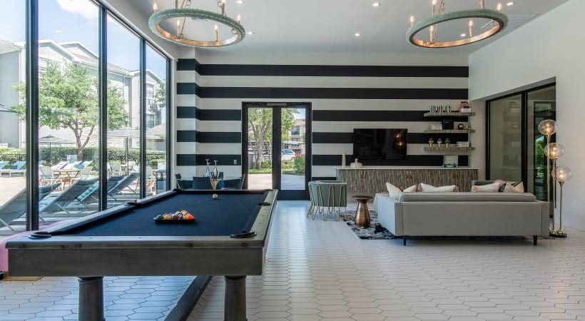 Resident clubhouse with pool table at Cortland North Beach