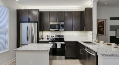 Modern apartment kitchen with stainless steel appliances