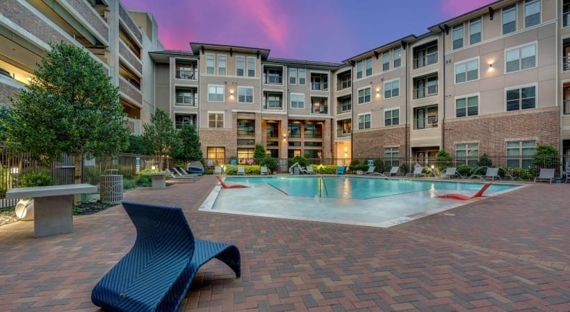 Resort-style pool with sundeck at the center of Circa Verus apartments near Stonebriar Mall