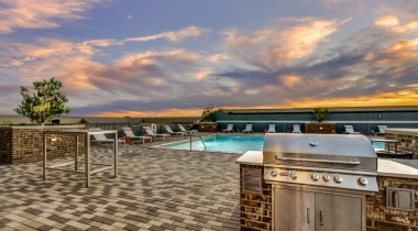 Our rooftop, saltwater pool with kitchen and gas grill at our luxury apartments near Shops at Legacy
