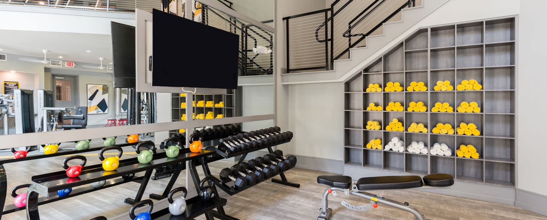 Fitness center at apartments in Allen, TX