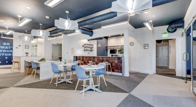 Lounge with kitchen at our upscale apartments for rent in Highlands Ranch, CO