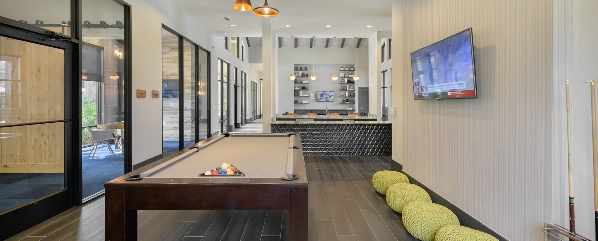 Resident clubhouse with pool table at Cortland Spring Plaza