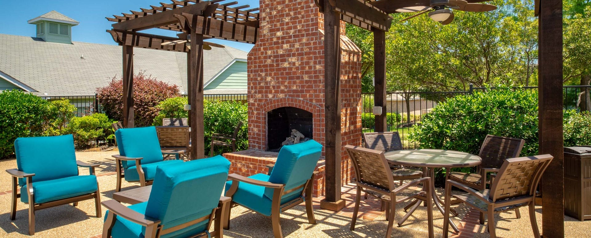 Outdoor lounge area with fireplace at 55 and up apartments
