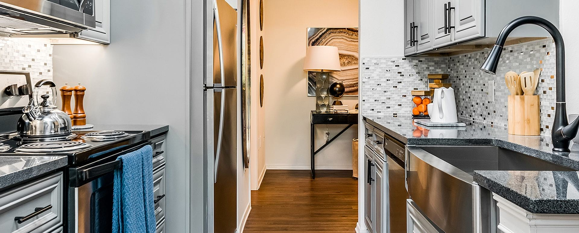 Kitchen with wood-style flooring at our Briargate apartments