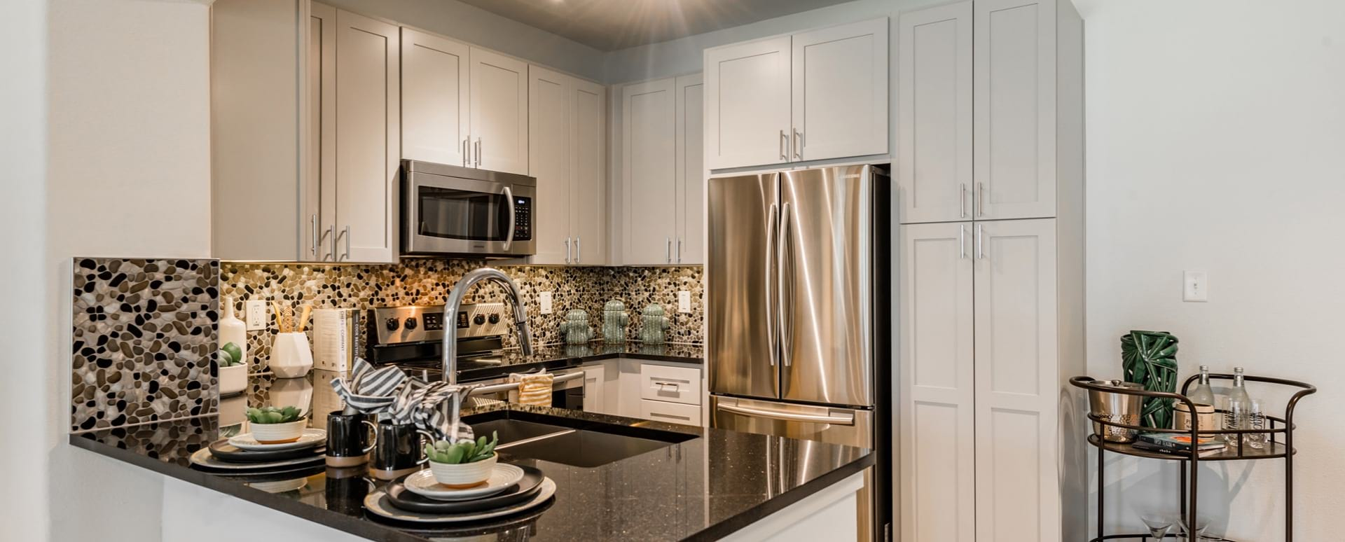 Spacious kitchen with stainless appliances at our upscale apartments in Houston, TX