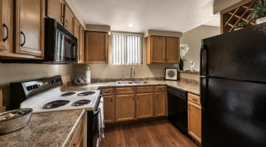 Kitchen with granite-style countertops at our modern apartments on Baseline in Phoenix