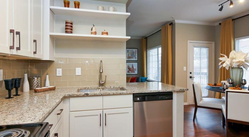 Granite Countertops with Designer Tile Backsplash