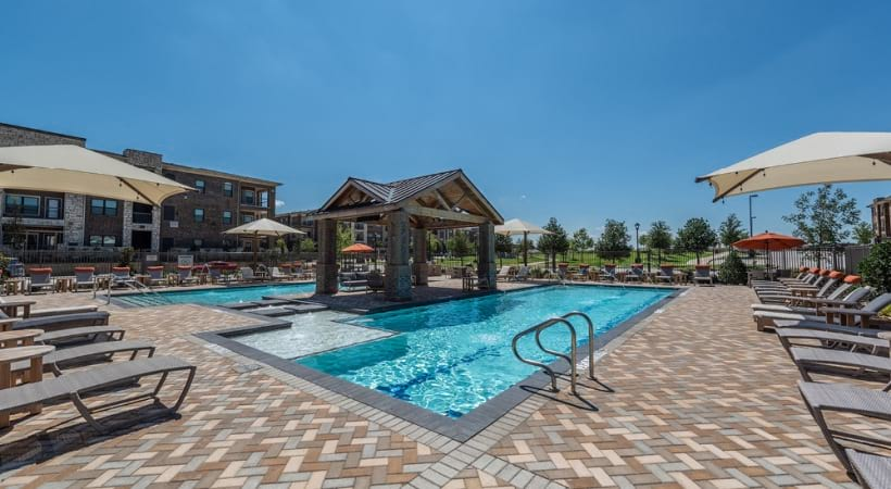 Our Little Elm apartment pool with sun deck at Cortland Phillips Creek Ranch