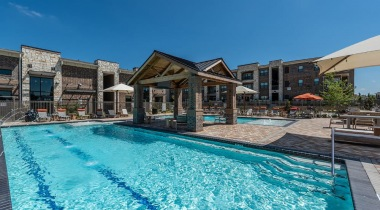 Resort-style pool at luxury apartments in Frisco, TX