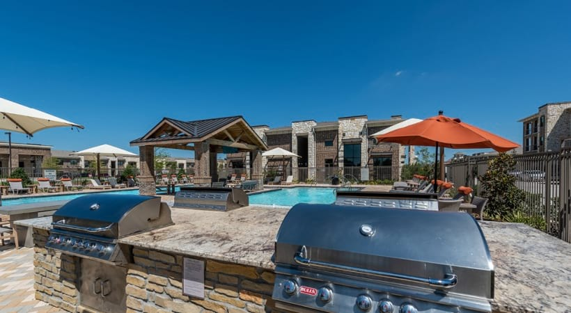 Outdoor gas grills at Cortland Phillips Creek Ranch apartments for rent in Little Elm, TX