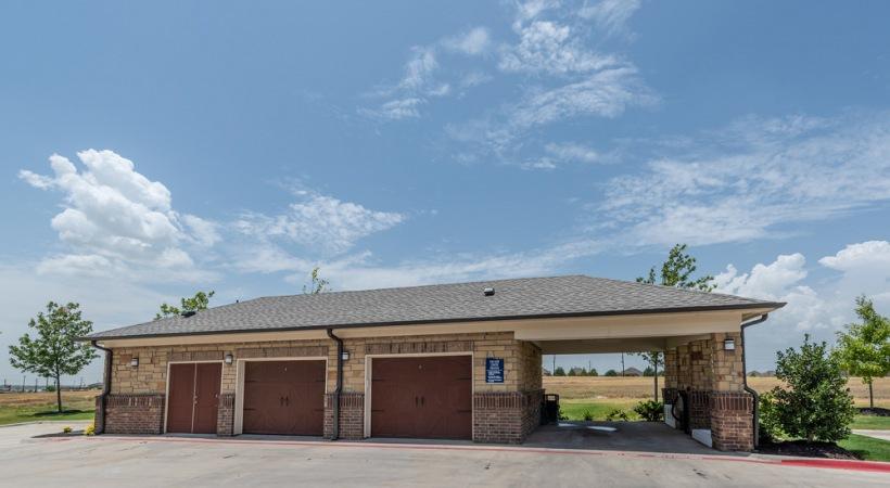 Car care center at Cortland Phillips Creek Ranch apartments near Little Elm, TX
