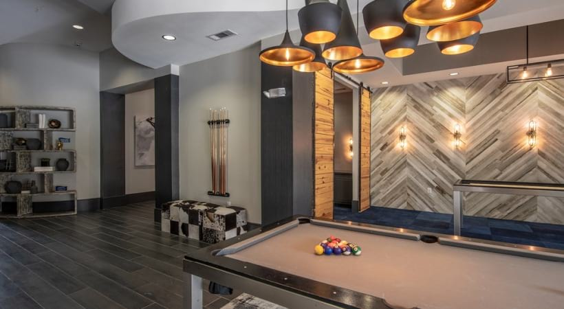 Our Little Elm apartment clubhouse with pool table
