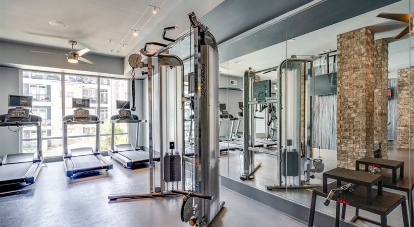 Our Raleigh, NC apartment gym with treadmills and other gym equipments