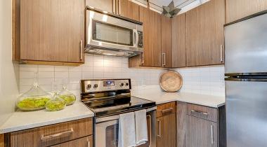 Stainless steel kitchen appliances and quartz countertops