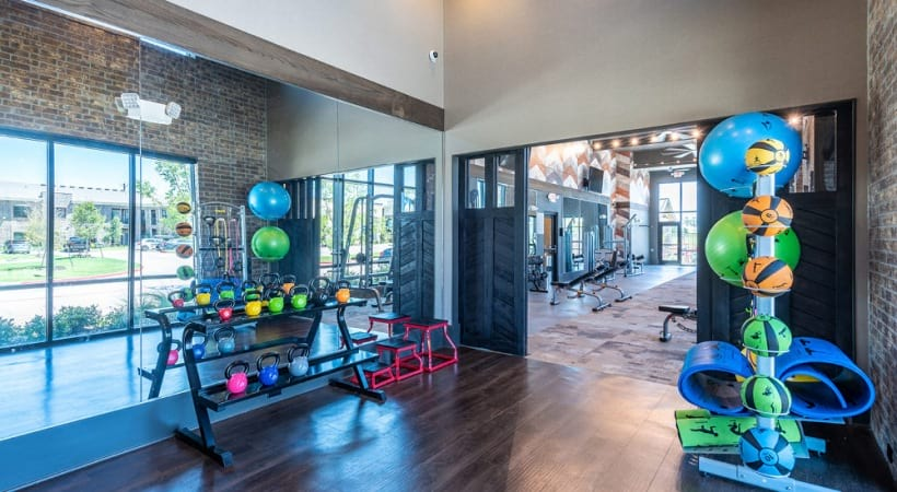 Fitness equipment at Cortland Phillips Creek Ranch apartment gym
