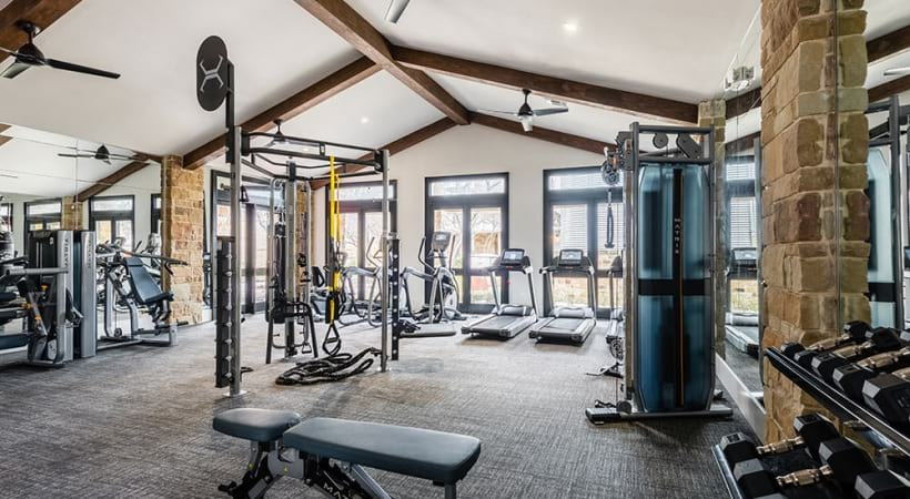 Fitness center with new equipment at our upscale apartments near USAA