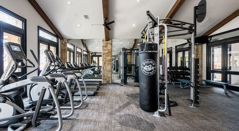 Our Medical Center apartment gym with cardio equipment