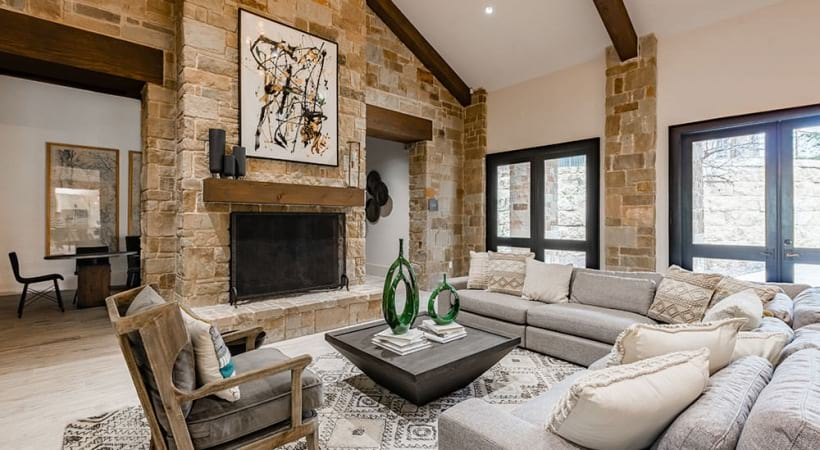 Modern seating and fireplace at our Cortland apartment clubhouse