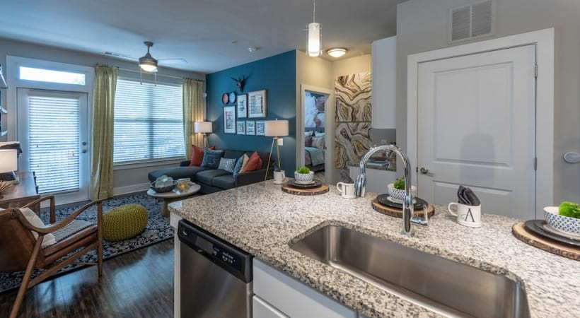 Kitchen Island with Granite Countertops and Gooseneck Faucet