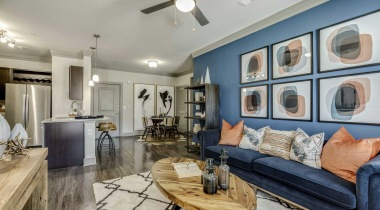 Living room with blue accent wall at our luxury apartments for rent in McKinney, TX