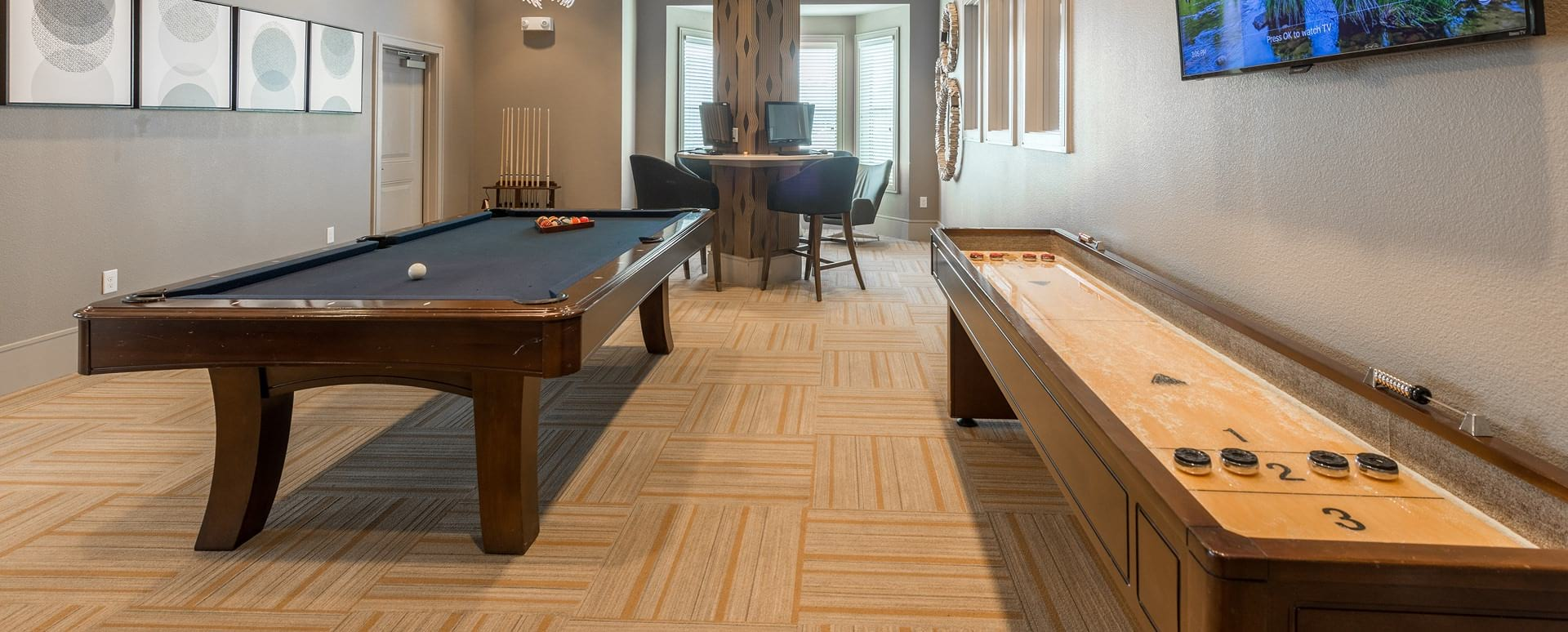 game room with billiards and skee tables